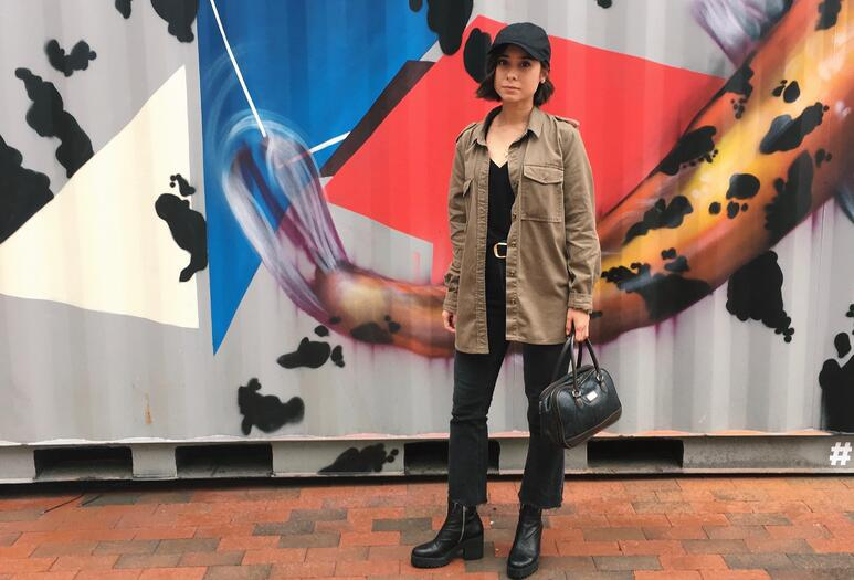 rainy day outfit, kick flare jeans, army jacket, baseball hat, platform boots