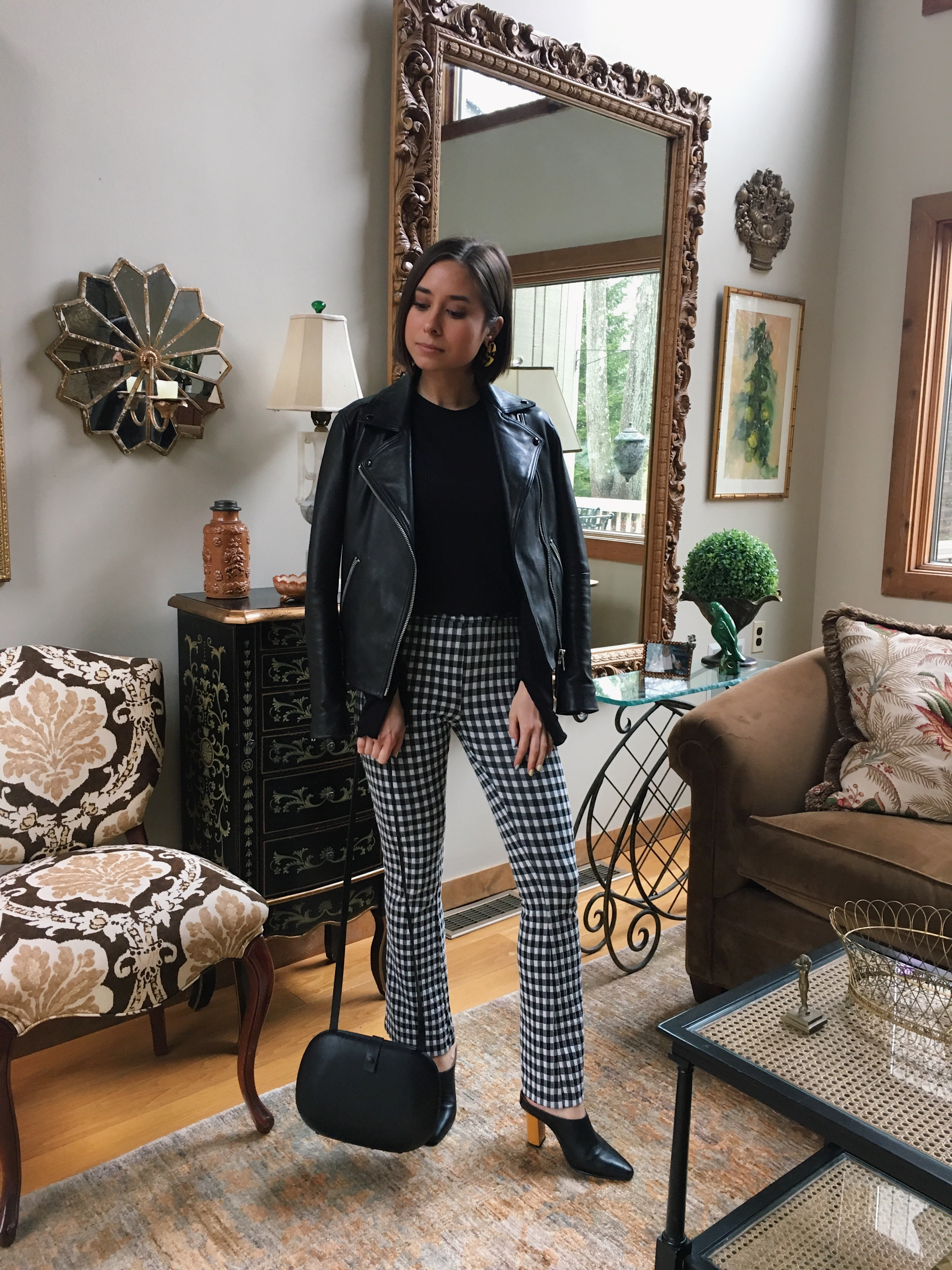 boston fashion blogger in gingham pants, leather jacket, heeled mules
