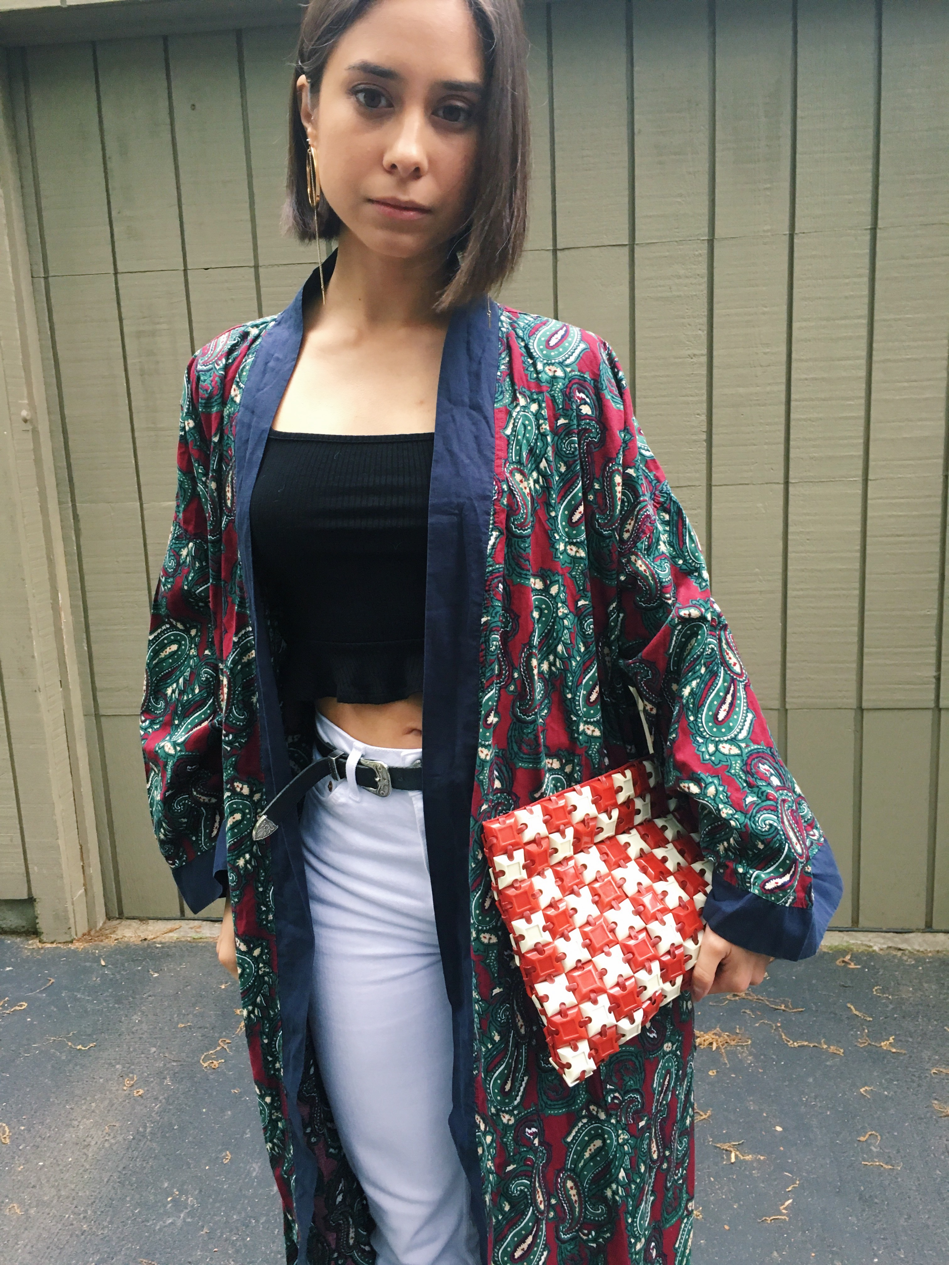 Fashion blogger That Time I Wore holds a vintage plastic tile clutch purse.